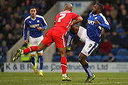 A high-leg from Chesterfield FC forward Sylvan Ebanks-Blake on Walsall FC midfielder Adam Chambers during the The FA Cup match between Chesterfield and Walsall at the Proact stadium, Chesterfield, England on 5 December 2015. Photo by Aaron Lupton.