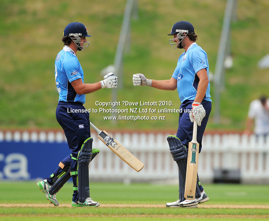 Auckland's Colin De Grandhomme and Greg Todd fist-bump after a boundary. One Day cricket - Wellington Firebirds v Auckland Aces at Allied Nationwide Finance Basin Reserve, Wellington on Wednesday, 2 February 2011. Photo: Dave Lintott / photosport.co.nz
