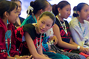 10 SEPTEMBER 2004 - WINDOW ROCK, AZ: Navajo girls in middle school wait to participate in a traditional talent contest the 58th annual Navajo Nation Fair in Window Rock, AZ. The Navajo Nation Fair is the largest annual event in Window Rock, the capitol of the Navajo Nation, the largest Indian reservation in the US. The Navajo Nation Fair is one of the largest Native American events in the United States and features traditional Navajo events, like fry bread making contests, pow-wows and an all Indian rodeo.  PHOTO BY JACK KURTZ