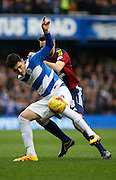 Queens Park Rangers midfielder Alejandro Faurlín holds off Ipswich Town midfielder Cole Skuse during the Sky Bet Championship match between Queens Park Rangers and Ipswich Town at the Loftus Road Stadium, London, England on 6 February 2016. Photo by Andy Walter.
