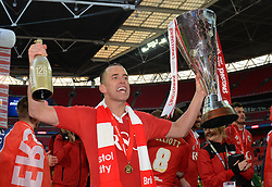 Bristol City's Aaron Wilbraham celebrates with the Johnstone Paint Trophy - Photo mandatory by-line: Dougie Allward/JMP - Mobile: 07966 386802 - 22/03/2015 - SPORT - Football - London - Wembley Stadium - Bristol City v Walsall - Johnstone Paint Trophy Final