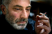 Portrait of Vitali Kaloyev smoking at home in Vladikavkaz, in North Ossetia in southern Russia. .The 52-year-old architect, who killed the air traffic controller blamed for the plane crash in which he lost his wife and two children, is being treated as a national hero..Kaloyev, who was freed November 2007 from a Swiss jail after serving less than four years, was appointed deputy construction minister for his home region..Kaloyev was building a holiday villa in Spain for a wealthy Russian when his wife Svetlana, 44, 10-year-old son Konstantin and four-year-old daughter Diana, set out to join him for a holiday in July 2002. As their plane flew over Germany it collided with a cargo jet killing all 71 people on board, most of them Russian schoolchildren..Investigators later established that Peter Nielsen, a Dane working for Skyguide, the Swiss air-traffic control service at Zurich airport, was the only person on duty. He had panicked when he realised the two planes were on a collision course and gave wrong instructions to the pilots..Like other bereaved relatives, Kaloyev grew angry at the slow pace of the investigation and the way Skyguide, fearful of lawsuits, sought to place the blame on others..Kaloyev claims he cannot remember what happened next, but does not deny stabbing Nielsen several times with a pocket knife. Nielsen bled to death before an ambulance could reach him. Kaloyev was arrested the following day and was sentenced to eight years for manslaughter.