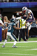 New England Patriots wide receiver Brandin Cooks (14) tries to jump over Philadelphia Eagles free safety Rodney McLeod (23) on a third down run good for one yard to the Eagles 8 yard line early in the second quarter during the 2018 NFL Super Bowl LII football game against the Philadelphia Eagles on Sunday, Feb. 4, 2018 in Minneapolis. The Eagles won the game 41-33. (©Paul Anthony Spinelli)