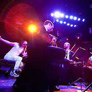 January 8, 2012 - Manhattan, NY : Andrew W.K. (piano, vocals), left, gestures as he performs with the Calder Quartet at Le Poisson Rouge in Manhattan on Sunday evening.  CREDIT: Karsten Moran for The New York Times