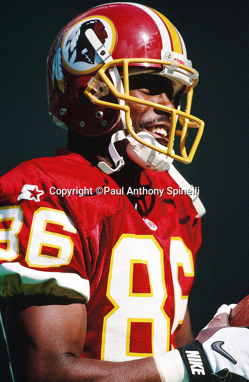 Washington Redskins wide receiver Leslie Shepherd (86) has a laugh on the sideline during the NFL football game against the Philadelphia Eagles on Oct. 8, 1995 in Philadelphia. The Eagles won the game 37-34 in overtime. (©Paul Anthony Spinelli)