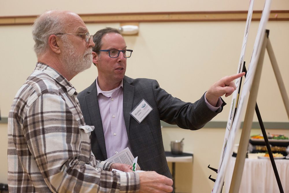 Bradley Cohen, right, the provost in the Park Place Strategy Work Group, explains a couple of the boards in the workshop to Tim Traxler, an Athens resident, during the public planning workshop at the Athens Community Center on Feb. 22, 2017.