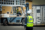 Moving a container with a forklift