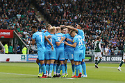 Luke Varney heads in the opening goal of the game and celebrates with his team mates  during the EFL Sky Bet League 2 match between Plymouth Argyle and Cheltenham Town at Home Park, Plymouth, England on 21 September 2019.
