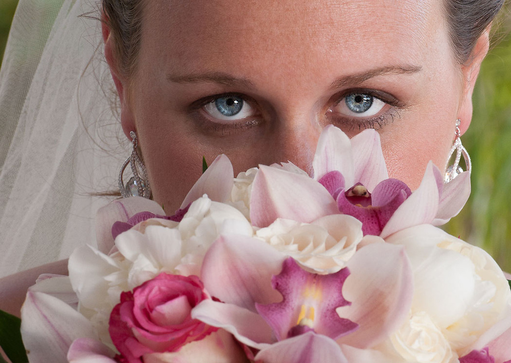 The bride's eyes with her flowers by Cayman wedding photographer Courtney Platt