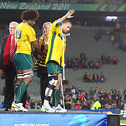 An injured Quade Cooper, Australia, on crutches, waves to the crowd after the medal presentation during the Australia V Wales Bronze Final match at the IRB Rugby World Cup tournament, Auckland, New Zealand. 21st October 2011. Photo Tim Clayton...