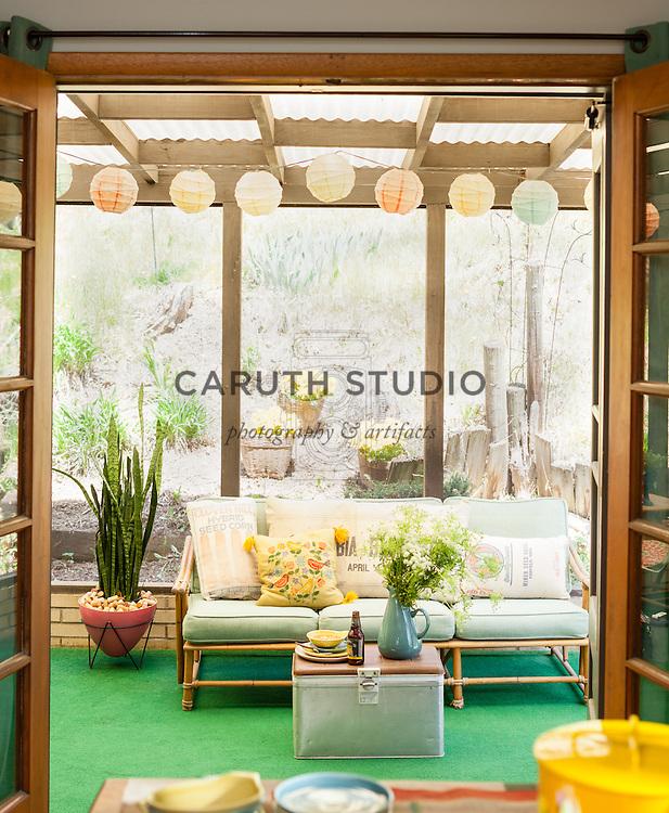 Three-season sunroom with midcentury furnishings
