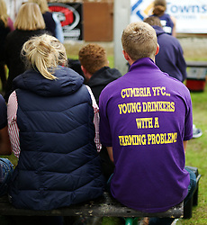 © Licensed to London News Pictures.14/07/15<br /> Harrogate, UK. <br /> <br /> A couple sit and watch the sheep shearing competition on the opening day of the Great Yorkshire Show.  <br /> <br /> England's premier agricultural show opened it's gates today for the start of three days of showcasing the best in British farming and the countryside.<br /> <br /> The event, which attracts over 130,000 visitors each year displays the cream of the country's livestock and offers numerous displays and events giving the chance for visitors to see many different countryside activities.<br /> <br /> Photo credit : Ian Forsyth/LNP