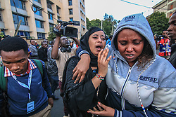 Jan 15, 2019 - Nairobi, Kenya - Family members seen reunited after walking away from an explosion from the attack, after an unknown number of armed gunmen and a suicide bomber launched an attack on Dustil Hotel in Nairobi. The attack left at least 6 dead and several injured, but the total number killed is not yet confirmed. The Somalia-based militant group al-Shabab said it was behind the attack. (Credit Image: © Donwilson Odhiambo/SOPA Images via ZUMA Wire)