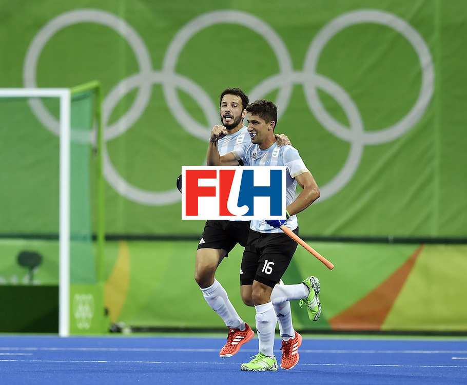 Argentina's Ignacio Ortiz (R) celebrates a goal during the men's Gold medal field hockey Belgium vs Argentina match of the Rio 2016 Olympics Games at the Olympic Hockey Centre in Rio de Janeiro on August 18, 2016. / AFP / PHILIPPE LOPEZ        (Photo credit should read PHILIPPE LOPEZ/AFP/Getty Images)
