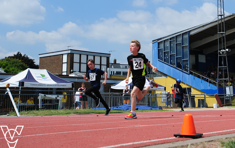 Metro Blind Sport's 2017 Athletics Open held at Mile End Stadium.  100m.  Competitor #67, left, and Ben Reynolds<br /> <br /> Picture: Chris Vaughan Photography for Metro Blind Sport<br /> Date: June 17, 2017