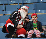 santa and his little helper take a break from their busy schedule during the Sky Bet Championship match between Burnley and Charlton Athletic at Turf Moor, Burnley, England on 19 December 2015. Photo by Mark Pollitt.