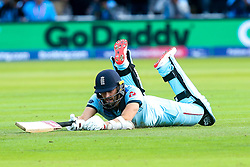 Mark Wood of England cuts a dejected figure after being run out - Mandatory by-line: Robbie Stephenson/JMP - 14/07/2019 - CRICKET - Lords - London, England - England v New Zealand - ICC Cricket World Cup 2019 - Final