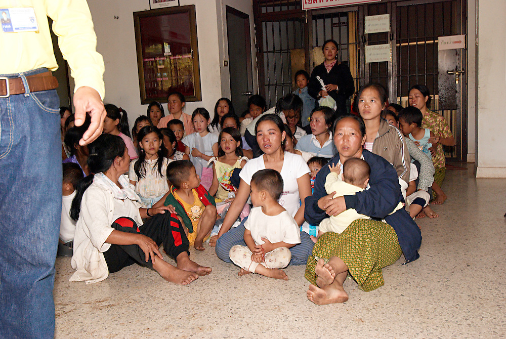 "There were tense scenes at the Nong Khai Immigration Detention Center as authorities tried to deport 152 Hmong refugees back to Laos, Nong Khai, Thailand, on Tuesday January 30th, 2007.  In protest the women and children sat in the street infront of the buses.  Some Hmong collapsed with emotion and exhaustion from the ordeal.  ..The deportation was postponed after the Hmong men barricaded their jail cell and threatened mass suicide if they were forcibly sent back to Laos where they face possible torture and death.  ..The men reportedly declared, ""We would rather die in Thailand than be sent back to Laos"".  ..On May 16, 2007 the Thai Military Junta forced the UNHCR Bangkok refugee office to stop accepting applications from asylum seekers.  On Friday night June 8, 2007, after UNHCR and western diplomats had gone home for the weekend, Thai authorities forcibly deported a different group of 160 Hmong asylum seekers to back Laos...Up to 1,000 Hmong jungle people surrendered to Lao authorities last year due to Lao Military pressure, an inability to defend themselves, and lack of food or medicine.   This includes Blia Shoua Her's group of 438 people who suffered the massacre April 6, 2006.  All of these Hmong have vanished and the Lao Government has made no account of their whereabouts or condition despite requests from humanitarian groups."