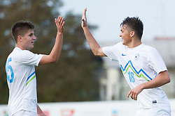 Jan Andrejasic and Luka Gajic of Slovenia celebrate during football game between Slovenia and Andorra of UEFA Under19 Championship Qualifications, on October 15, 2013 in Bakovci, Slovenia. (Photo by Erik Kavas / Sportida)