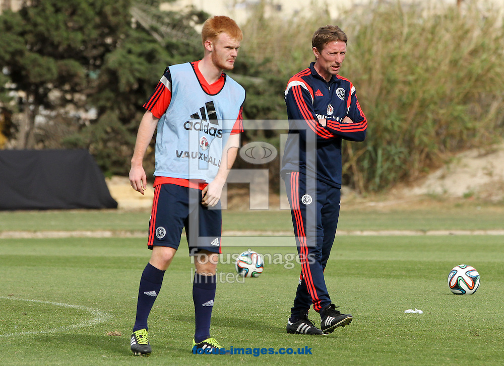 Jack Breslin (left) of Scotland trains as Scotland U17 manager Scot Gemmill (right) watches on at the Hibernians Stadium, Paola<br /> Picture by Tom Smith/Focus Images Ltd 07545141164<br /> 17/05/2014