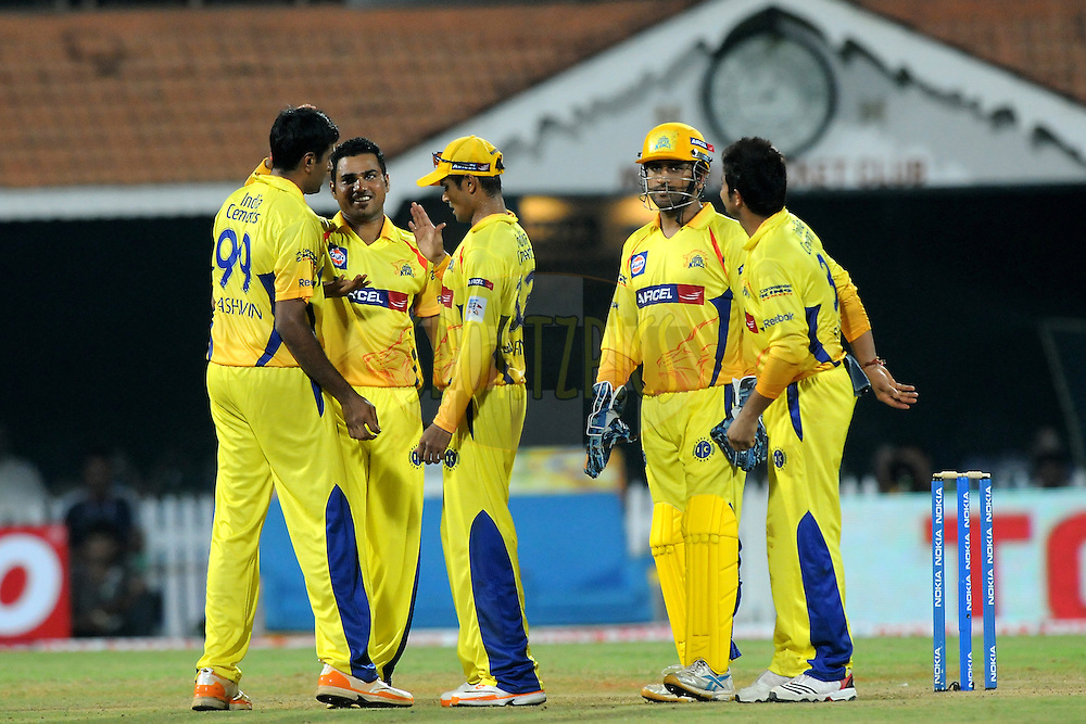 Team Chennai Super Kings celebrate a wicket  during match 3 of the NOKIA Champions League T20 ( CLT20 )between the Chennai Superkings and the Mumbai Indians held at the M. A. Chidambaram Stadium in Chennai , Tamil Nadu, India on the 24th September 2011..Photo by Pal Pillai/BCCI/SPORTZPICS