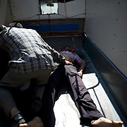August 10, 2012 - Aleppo, Syria: A man and a woman mourn the death of their son, killed minutes earlier by heavy shelling from the Syrian Army against a bakery in the residential area of Tariq Al-Bab in central Aleppo. At least 12 people have died and more the 20 got injured during the attack...The Syrian Army have in the past week increased their attacks on residential neighborhoods where Free Syria Army rebel fights have their positions in Syria's commercial capital, Aleppo.