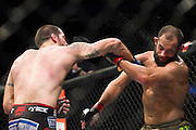 DALLAS, TX - MARCH 14:  Matt Brown punches Johny Hendricks during UFC 185 at the American Airlines Center on March 14, 2015 in Dallas, Texas. (Photo by Cooper Neill/Zuffa LLC/Zuffa LLC via Getty Images) *** Local Caption *** Matt Brown; Johny Hendricks