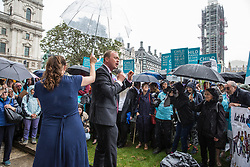 London, UK. 18 June, 2019. Tim Farron, former leader of the Liberal Democrats, addresses a demonstration in Parliament Square to demand that the Government resettle 10,000 unaccompanied refugee children over 10 years. As part of Lord Dubs' 'Our Turn' campaign, councils around the UK have already pledged places for over 1,100 children if the Government should make a new resettlement commitment.