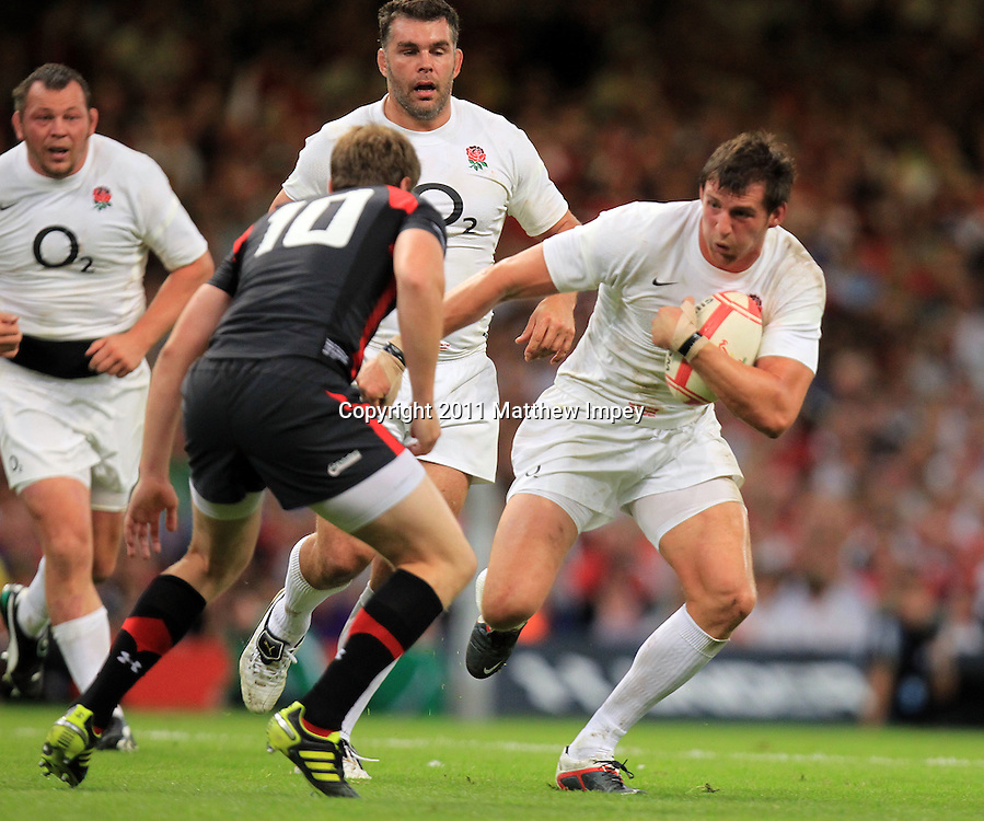 Tom Wood of England runs at Rhys Priestland of Wales. Wales v England, Millennium Stadium, Cardiff, Rugby Union, 12/08/2011 © Matthew Impey/Wiredphotos.co.uk. tel: 07789 130 347 email: matt@wiredphotos.co.uk