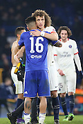Paris Saint Germain defender David Luiz (32) hugging Chelsea attacker Kenedy (16) after beating Chelsea during the Champions League match between Chelsea and Paris Saint-Germain at Stamford Bridge, London, England on 9 March 2016. Photo by Matthew Redman.