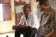 Elisha Ayibasiya talking with VSO volunteer Damien Gregory, at Tonga Junior High School, Ghana.