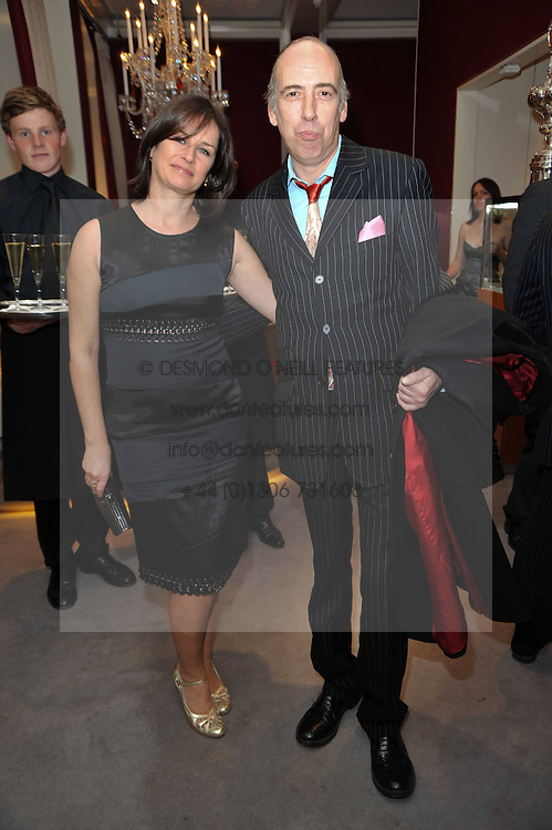 MICK JONES and his wife  Miranda Davies at a party to launch the Georgina Chapman collection for Garrard held at Garrard, Albermarle Street, London on 4th November 2009.