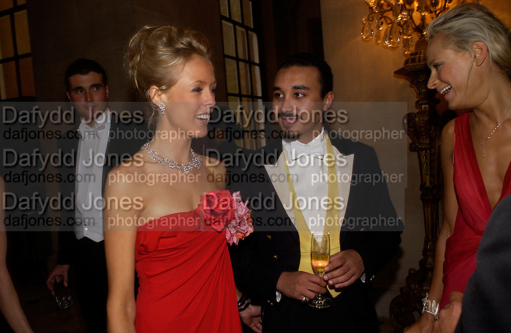 Lady Alexandra Spencer-Churchill, Kalita Al-Swadi and Prince Khalid bin Bandar, Ball at Blenheim Palace in aid of the Red Cross, Woodstock, 26 June 2004. SUPPLIED FOR ONE-TIME USE ONLY-DO NOT ARCHIVE. © Copyright Photograph by Dafydd Jones 66 Stockwell Park Rd. London SW9 0DA Tel 020 7733 0108 www.dafjones.com