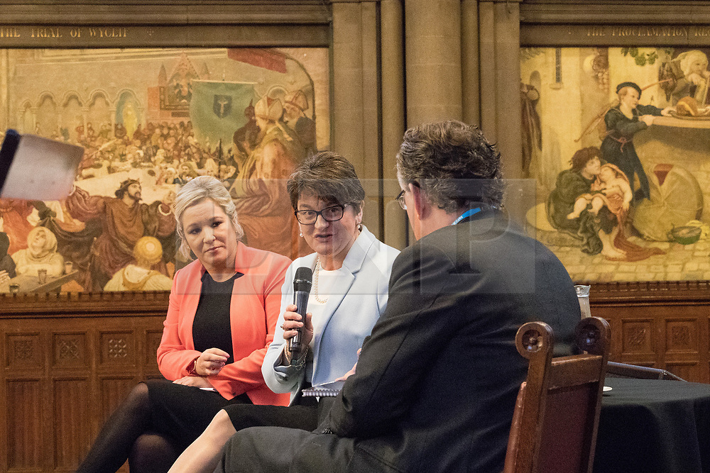 © Licensed to London News Pictures  . 03/10/2017 . Manchester , UK . MICHELLE O'NEILL , leader of Sinn Fein and ARLENE FOSTER MLA , leader of the Democratic Unionist Party ( DUP ) in front of Ford Madox Brown's The Trial of Wyclif and The Proclamation Regarding Weights and Measures murals , at a fringe event in the Great Hall in Manchester Town Hall during day three of the Conservative Party Conference at the Manchester Central Convention Centre . Photo credit : Joel Goodman/LNP