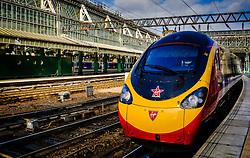 A Virgin express passenger train departing Glasgow Central Station bound for London Euston<br /> <br /> (c) Andrew Wilson | Edinburgh Elite media