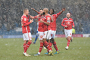 Walsall Midfielder, Anthony Forde is mobbed by his team mates after scoring Walsalls third  during the Sky Bet League 1 match between Bury and Walsall at Gigg Lane, Bury, England on 16 January 2016. Photo by Mark Pollitt.