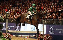 Richard Hughes competes in the Markel Champions Challenge in aid of the Injured Jockeys Fundduring day four of the London International Horse Show at London Olympia. PRESS ASSOCIATION Photo. Picture date: Friday December 15, 2017. See PA story EQUESTRIAN Olympia. Photo credit should read: Steve Parsons/PA Wire