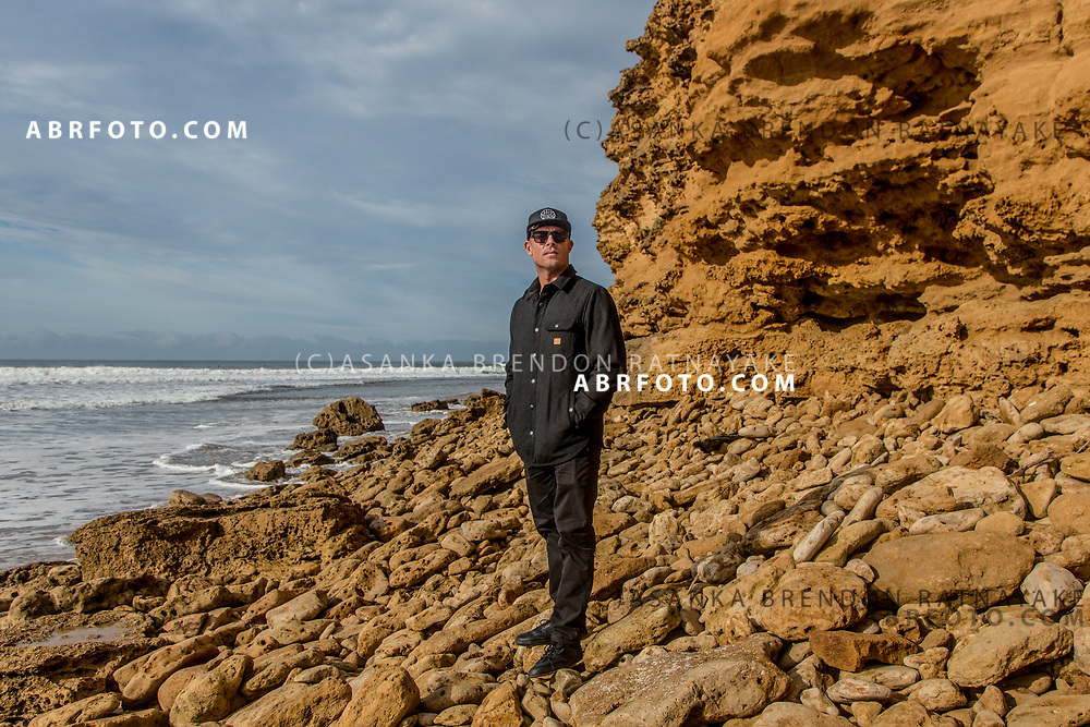 Surfer Mick Fanning poses for a portrait in front of the rocks at Bells Beach on the south west coast of Victoria, Australia on the 27th of March 2018. Asanka Brendon Ratnayake for The New York Times.