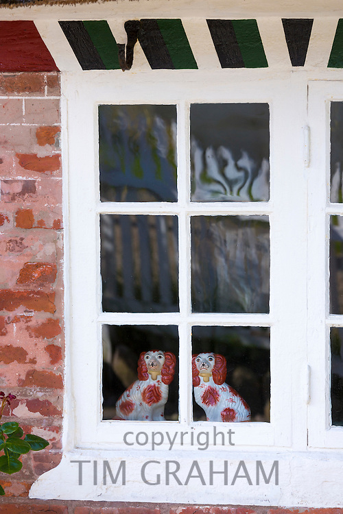 Traditional Staffordshire dog figurines in window of cottage house on Fano Island - Fanoe - South Jutland, Denmark
