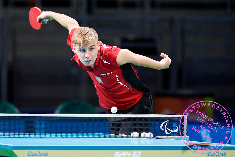 Rio de Janeiro, Brazil - 2016 September 03: Piotr Grudzien from Poland plays during table tennis training session in Riocentro Pavilion 3 while 2016 Summer Paralympic Games on September 03, 2016 in Rio de Janeiro, Brazil.<br /> Rio 2016 Paralympic Games will be held from September 7 until 18.<br /> <br /> Adam Nurkiewicz declares that he has no rights to the image of people at the photographs of his authorship.<br /> <br /> Picture also available in RAW (NEF) or TIFF format on special request.<br /> <br /> Any editorial, commercial or promotional use requires written permission from the author of image.<br /> <br /> Mandatory credit:<br /> Photo by &copy; Adam Nurkiewicz / Mediasport