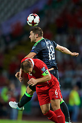 BELGRADE, SERBIA - Sunday, June 11, 2017: Wales' Sam Vokes and Serbia's captain Branislav Ivanovic during the 2018 FIFA World Cup Qualifying Group D match between Wales and Serbia at the Red Star Stadium. (Pic by David Rawcliffe/Propaganda)