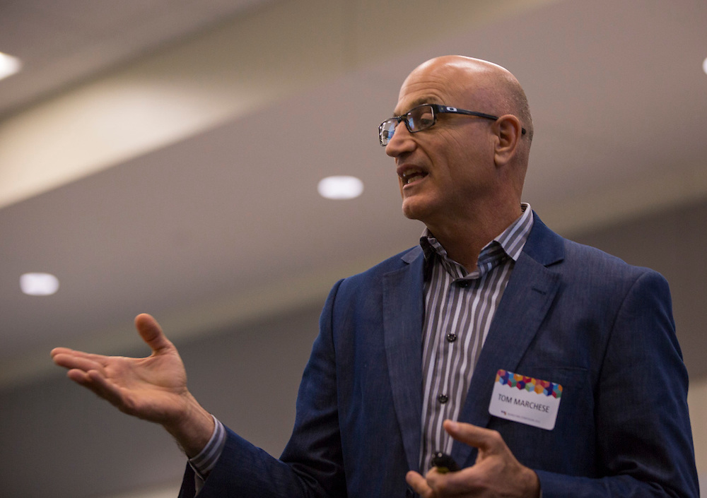 """Tom Marchese, Executive-in-Residence and Associate Director of Ohio University College of Business Honors Program, gives a presentation titled """"Building Brands in a Digital World"""" during the Marketing Symposium on November 4, 2015 in Schoonover Center. Photo by Emily Matthews"""
