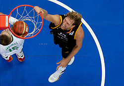 Robertas Javtokas of Lithuania and Dirk Nowitzki of Germany during basketball game between National basketball teams of Lithuania and Germany at FIBA Europe Eurobasket Lithuania 2011, on September 11, 2011, in Siemens Arena,  Vilnius, Lithuania. Lithuania defeaed Germany 84-75. (Photo by Vid Ponikvar / Sportida)