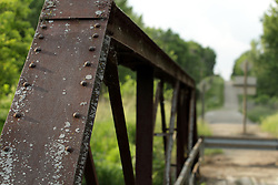 Panther Creek Bridge, a Warren Cantilever Bedstead steel beam bridge built in 1925 spans Panther Creek in Woodford County Illinois between Secor and El Paso.  The bridge is derelict, abandoned and in disrepair.  The creek beneath and surround land thrive