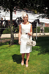 TV presenter GEORGIE THOMPSON at day 1 of the annual Glorious Goodwood racing festival held at Goodwood Racecourse, West Sussex on 28th July 2009.