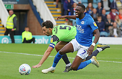 Mohamed Eisa of Peterborough United in action with Will Nightingale of AFC Wimbledon - Mandatory by-line: Joe Dent/JMP - 28/09/2019 - FOOTBALL - Weston Homes Stadium - Peterborough, England - Peterborough United v AFC Wimbledon - Sky Bet League One