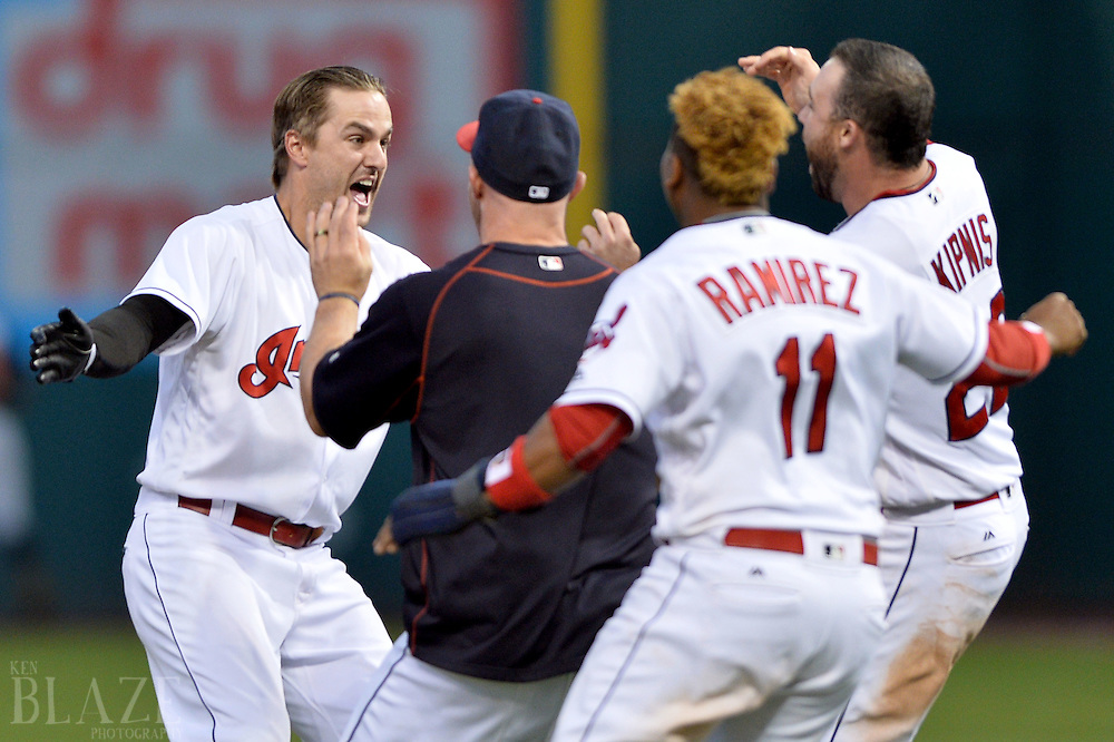 Sep 4, 2016; Cleveland, OH, USA; Cleveland Indians right fielder Lonnie Chisenhall (8) celebrates with Cleveland Indians catcher Chris Gimenez (38), third baseman Jose Ramirez (11) and second baseman Jason Kipnis (22) after hitting a game winning single during the ninth inning to beat the Miami Marlins 6-5 at Progressive Field. Mandatory Credit: Ken Blaze-USA TODAY Sports