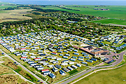 Nederland, Friesland, Ameland, 05-07-2018; Ballum, familiecamping Roosduinen, chalets en stacaravans.<br /> Ballum, family camping Roosduinen, chalets and mobile homes.<br /> luchtfoto (toeslag op standard tarieven);<br /> aerial photo (additional fee required);<br /> copyright foto/photo Siebe Swart