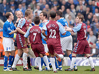 Photo. Glyn Thomas, Digitalsport<br /> Birmingham City v Aston Villa <br /> Barclays Premiership. 20/03/2005.<br /> Tempers flare during the Birmingham derby, and after this confrontation Martin Laursen was shown the yellow card.