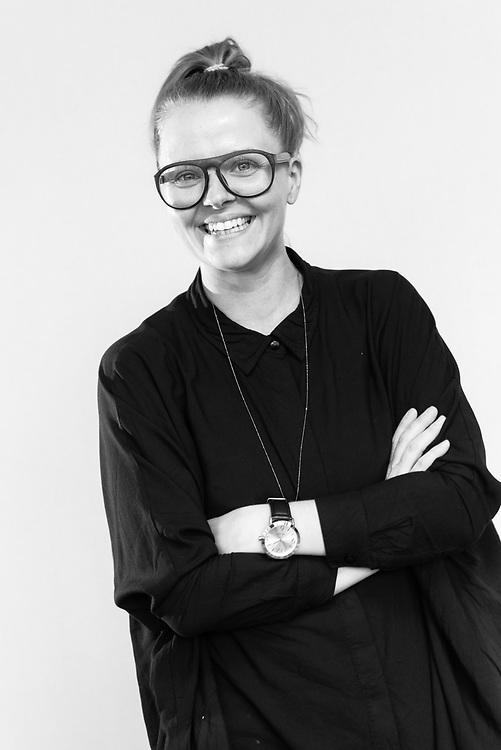 A black and white portrait photograph of a UX Copenhagen team member
